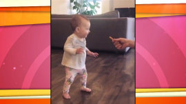 A french fry entices this baby into taking her first steps