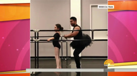 Watch a dad wear a tutu and participate in his daughter's ballet class