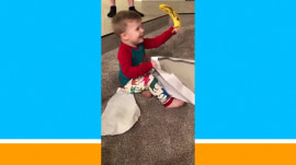This 2-year-old boy loves his Christmas gift: A banana