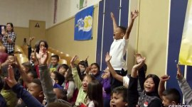 Watch football players surprise schoolkids: 'Everybody is getting a bike'