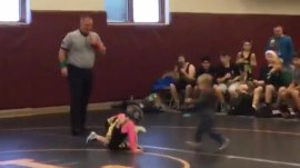 Girl's little brother leaps in to defend her in youth wrestling match