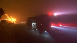 California wildfires spur new evacuations as flames move toward coast