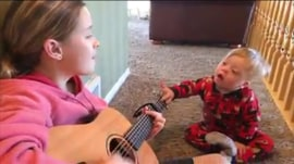 Watch 2-year-old boy with Down syndrome sing with his big sis