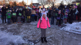 Hundreds welcome 8-year-old girl back to school after cancer treatment