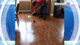 Watch this young Olympics fan practice curling (with a Swiffer)