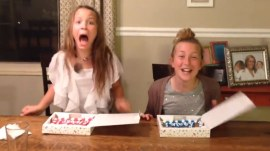 See this mom use a cookie cake to tell her daughters she's pregnant