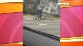 Watch this driver help a man with a walker cross the street