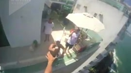 Watch this paraglider snatch a beer from a balcony