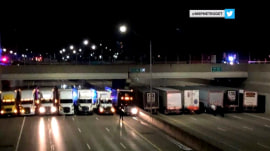 Truck drivers team with cops to discourage man from suicide attempt