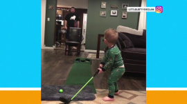 Watch this little boy nail a Pringles can with a golf shot