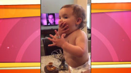 Watch this baby try on her mom's wedding ring