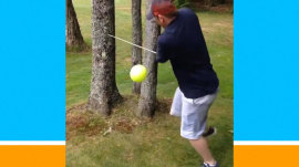 Golfer tries to take a swing near a tree... and it doesn't go well