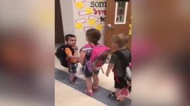 Handshakes, smiles and hugs: Why these elementary school students start their day the same way