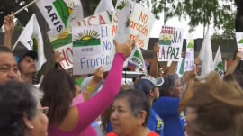 Supporters at US-Mexico border stand in solidarity with migrant children still in custody