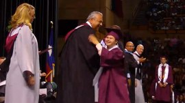 Watch this joyous high school grad hop, skip and dance across the stage