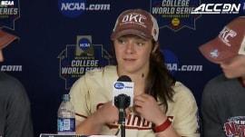 Watch a very big bug interrupt softball catcher's press interview