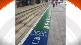 Should there be pedestrian lanes just for people looking at their phones?
