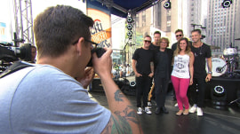 Watch a lucky fan pose for a fun photo with OneRepublic!