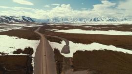 Ride along the scenic and vast Dalton Highway in Alaska