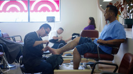 Inside a state prison where male inmates go to beauty school