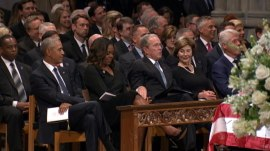 George W. Bush and Michelle Obama share sweet moment at McCain's funeral