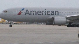 12 passengers quarantined on 2 American Airlines flights