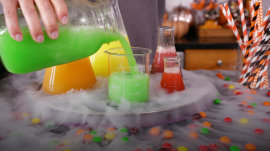 These fruity Skittles Slushies are the ultimate Halloween party drink