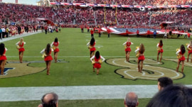 NFL cheerleader takes a knee during national anthem