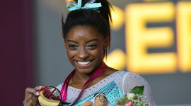 Simone Biles makes history winning 4th all-around world title