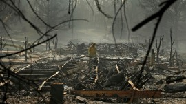 Trump visits California as wildfires death toll rises