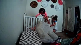 Girl helping sister escape from crib shows ultimate teamwork