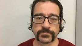 Wanted criminal engages with police in funny Facebook post