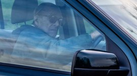 Prince Philip seen driving without seatbelt days after car wreck