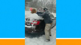 Watch: Clever dad finds a silly way to clear snow off the car