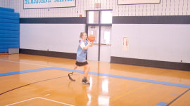 Leg amputee perseveres to become varsity basketball star