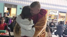 Military dad, dressed as school mascot, has touching reunion with daughter