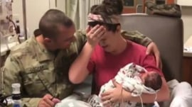 Military dad meets newborn twins in surprise homecoming
