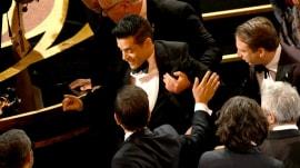 Rami Malek takes a tumble off the Oscars stage