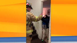 Firefighter signs with boy with cerebral palsy, and more Highs and Lows