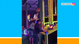 Dad on baby duty still determined to play arcade hoops