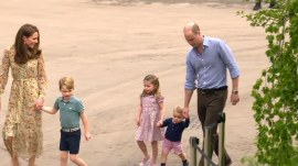Prince George, Princess Charlotte and Prince Louis play in garden