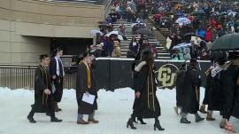 CU Boulder graduates embrace their 'snow-mencement'