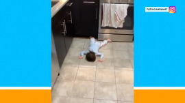 Toddler catches some shut-eye on the kitchen floor