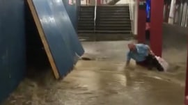 Man nearly swept into moving NYC train by floodwaters