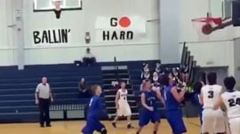 Video: High school basketball player makes a layup, with his face