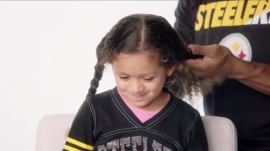Unnecessary cuteness! Little girls get their hair done by their NFL dads