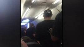 Video: Passengers applaud as unruly passenger removed from flight