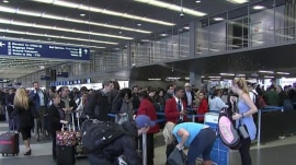 Long lines at airport TSA security checkpoints could last all summer