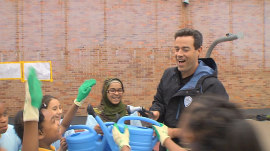 Carson Daly helps NYC schoolkids build a garden