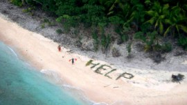 Castaways spell H-E-L-P in palm leaves – and it works!